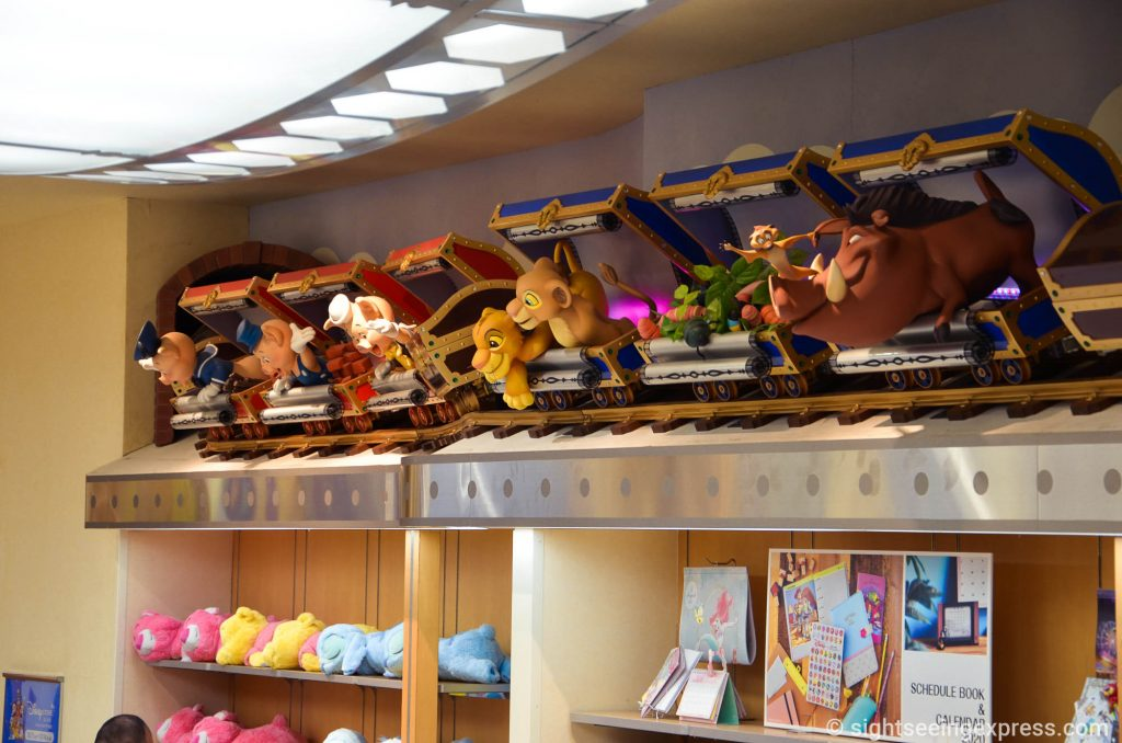 Disney dolls popping out from suitcases at the Disney store
