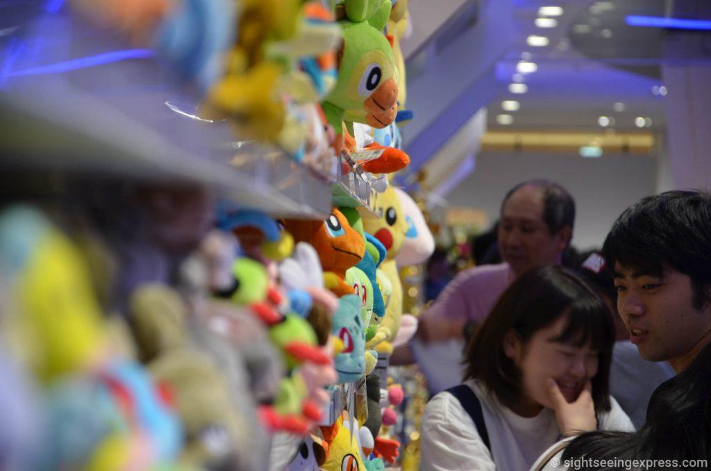 Many Pokémon figures no the shelves at the Pokémon Osaka DX store