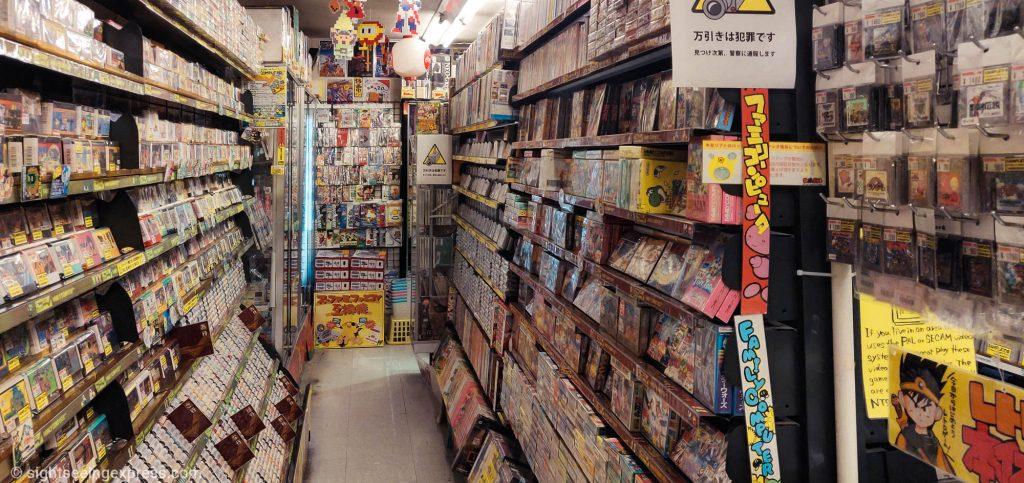 shelves with retrogames at Super Potato store